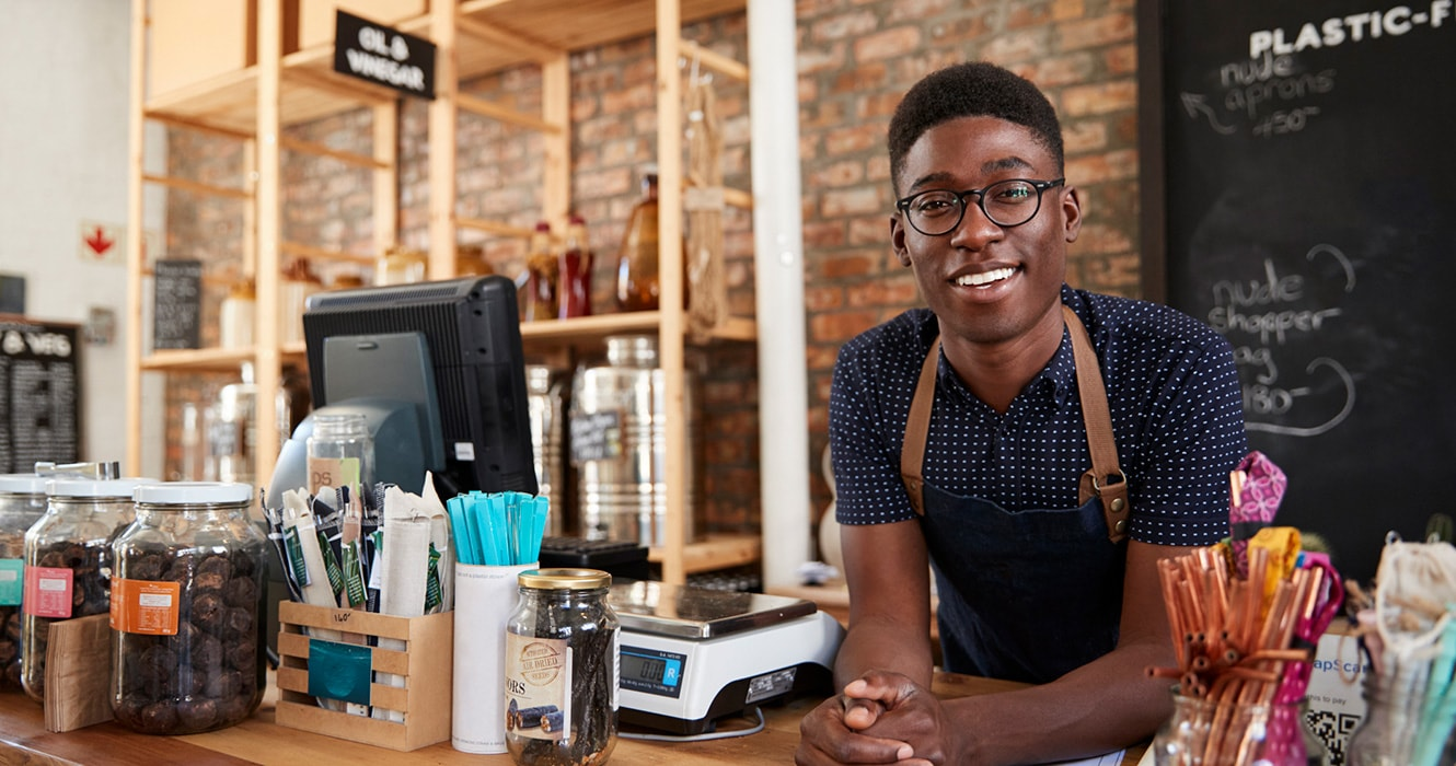 Young barista working at coffee shop